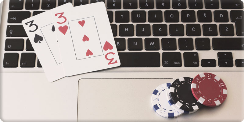 Online poker Cards and chips on keyboard