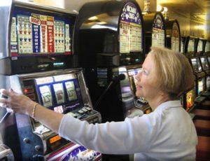 Online Gambling Woman playing Slot Machines