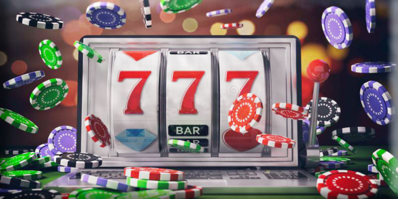 Online Slots Slot machine on laptop screen and falling poker chips